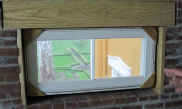 inside view of attic transom window replicated by Welch Millwork and Design
