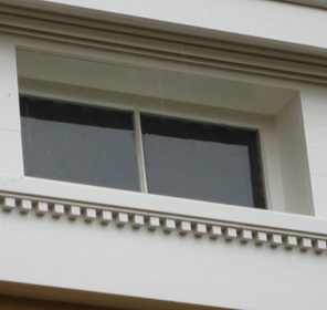outside view of attic transom window replicated by Welch Millwork and Design